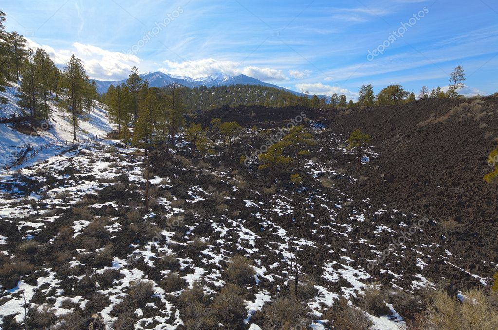 Snow on a lava field at Sunset Crater in Arizona — Stock Photo #7298025