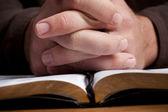 Man Praying with Bible — Stock Photo