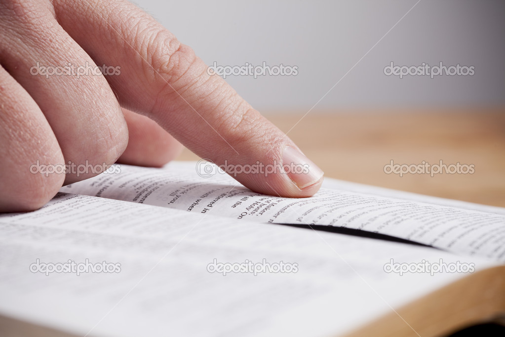 Close up of man reading through the Bible. — Stock Photo #7301865