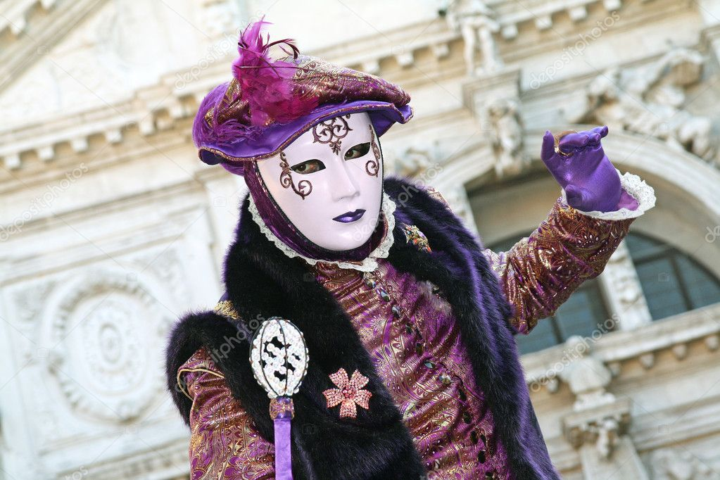 VENICE, ITALY - MARCH 4 2011: Detail of unidentified masked person standing in front of Chiesa di San Mois in Venice, Italy, on 4 March during popular Venice c  Stock Photo #7251195