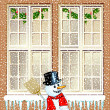 Snowman in front of the house — Stock Vector