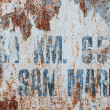 Stock Photo: Rusting painted wall