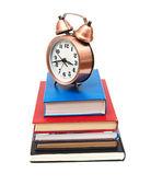 时钟和白色背景上的书 — 图库照片