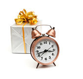 A retro clock with presents on white background — Stock Photo