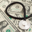 Stethoscope and dollars - Photo