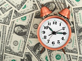 Alarm clock on a stack of dollars, — Stock Photo