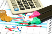 Calculator, coins and pen laying on chart. — Stock Photo