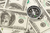 Compass on money background — Foto Stock