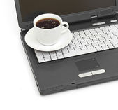 A cup of coffee on a laptop — Stock Photo