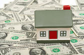 Miniature House on Money. — Stock Photo