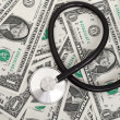 Stock Photo: Stethoscope and dollars