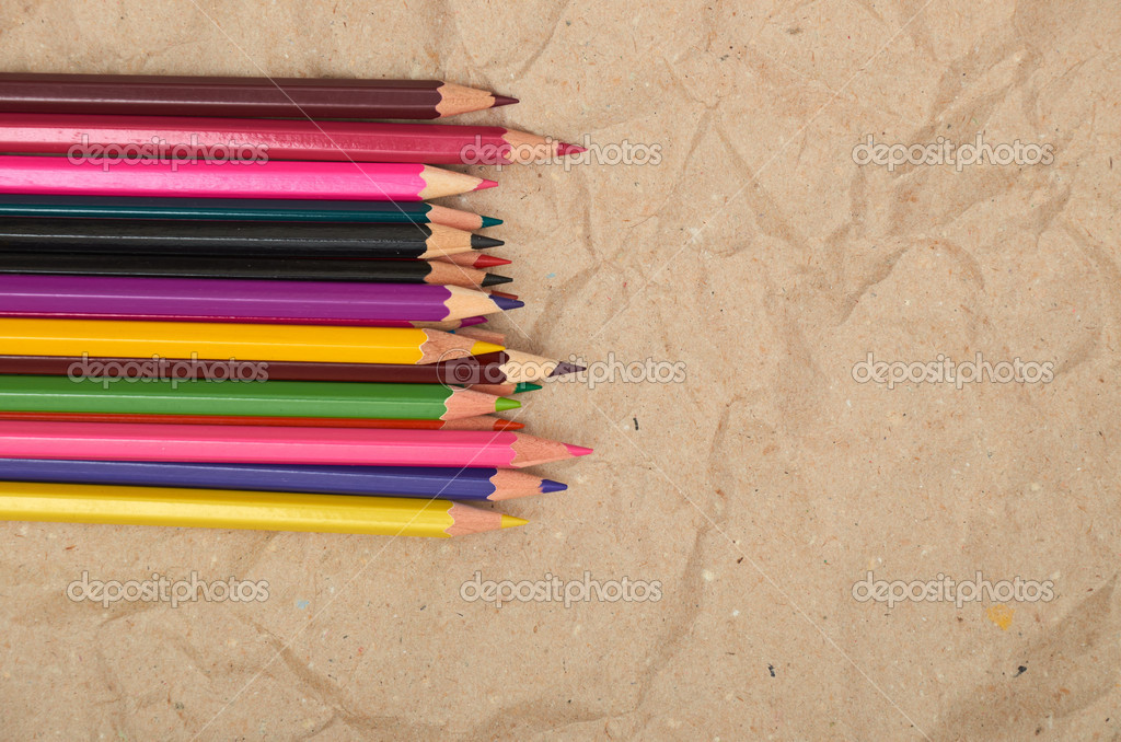 Old paper sheet and stack of colored pencils  Foto Stock #6956951