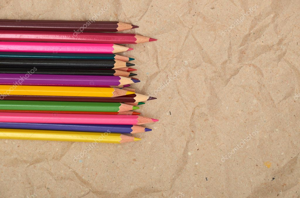 Old paper sheet and stack of colored pencils — Stockfoto #6956951