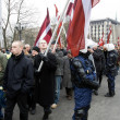 Latvian Nationalists with flags — Stock Photo
