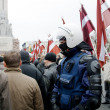 Riot policeman in crowd — Stock Photo #7924472