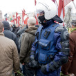 Riot policeman in crowd — Stock Photo