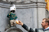 Manneken Pis dressed in uniform — Stock Photo
