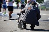 Professional photographer at Riga International Marathon — Stock Photo