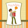 Birthday card with boy and big gift box - Foto Stock