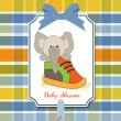Baby shower card with teddy bear hidden in a shoe - Stock Photo