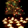 Candles and the christmas tree — 图库照片