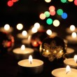 Candles and the christmas tree — Stock Photo