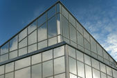 Angle of modern glass building — Stock Photo