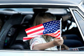 Child with American flag — Stok fotoğraf