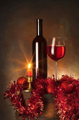 Still life with red wine and christmas atmosphere — Stock Photo