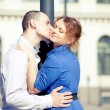 Young couple kisser at the nature - side view — Stock Photo