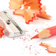 Red crayon wiht shavings — Stock Photo #7734398