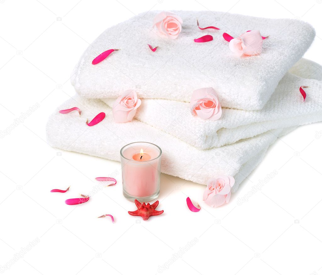 White towels with pink soap roses and candle on white background — Stock Photo #7579497