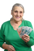 Old woman with money — Stock Photo