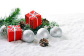 Christmas gifts on snow — Stock Photo