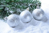 Silver christmas balls on snow — Stock Photo