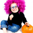 Stock Photo: Little clown with pumpkin