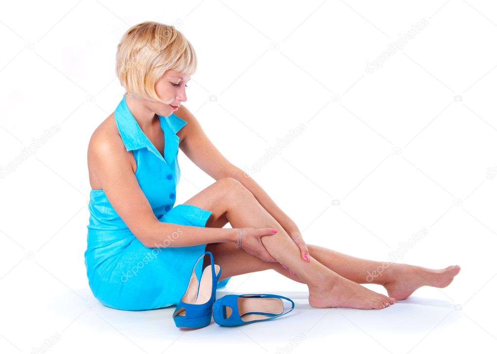 The girl's feet hurt, white background  Stock Photo #6828607