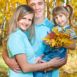 Young family, autumn — Stock Photo