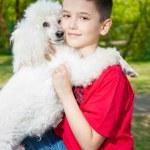 A boy hugs his dog — Stock Photo