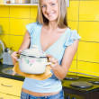 Girl with a saucepan - Stock Photo
