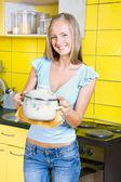 Girl with a saucepan — Stock Photo