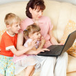 Family for a laptop — Stock Photo