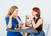 Two women drinking tea — Stock Photo