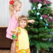 Children decorate the Christmas tree — Stock Photo #7415284