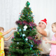 Stock Photo: Children decorate Christmas tree
