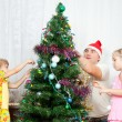 Children decorate the Christmas tree — Stock Photo #7415336
