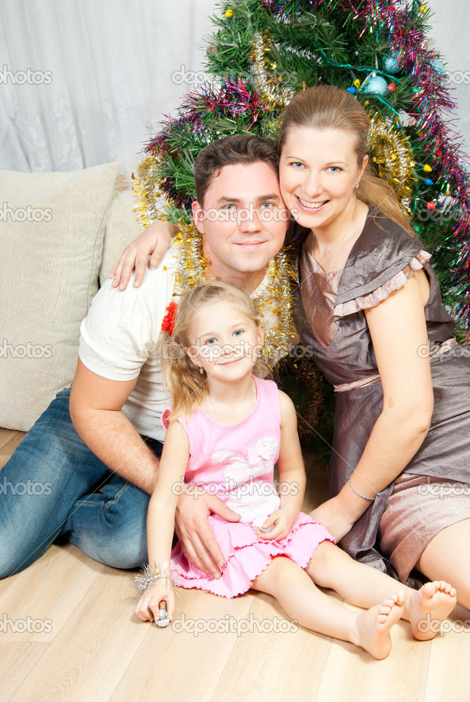 Happy family at Christmas spruce — Stock Photo #7415160