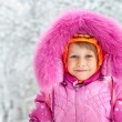 The little girl in the snow - Photo