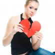 A girl shows a symbol of love destroyed — Stock Photo