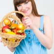A pregnant woman with fruit — Stock Photo